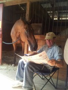 Popstarr and Ed read the morning paper, 2013