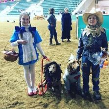 Mary and Sam with Annie and Daisy in the dog costume class, 2015